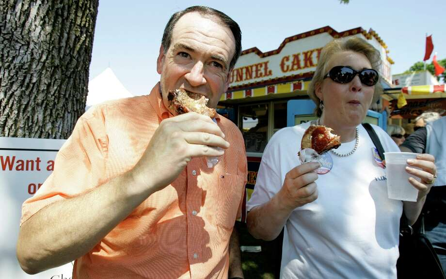 Here, Mike Huckabee eats the same pork chop at the same event four years earlier. (AP) Photo: Charlie Neibergall, ASSOCIATED PRESS / AP2007