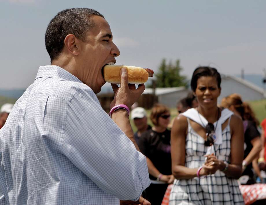 Being seen with a hot dog is always good for your normal Joe image, but it can be tricky. (AP) Photo: Jae C. Hong, ASSOCIATED PRESS / AP2008