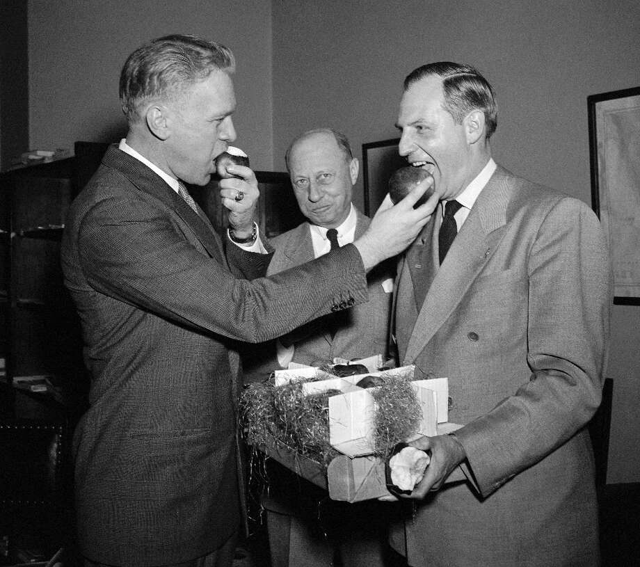 Sometimes they make you feed other people. Probably not the best idea for a photo op, Gerry. (AP) Photo: Bill Allen, ASSOCIATED PRESS / AP1950