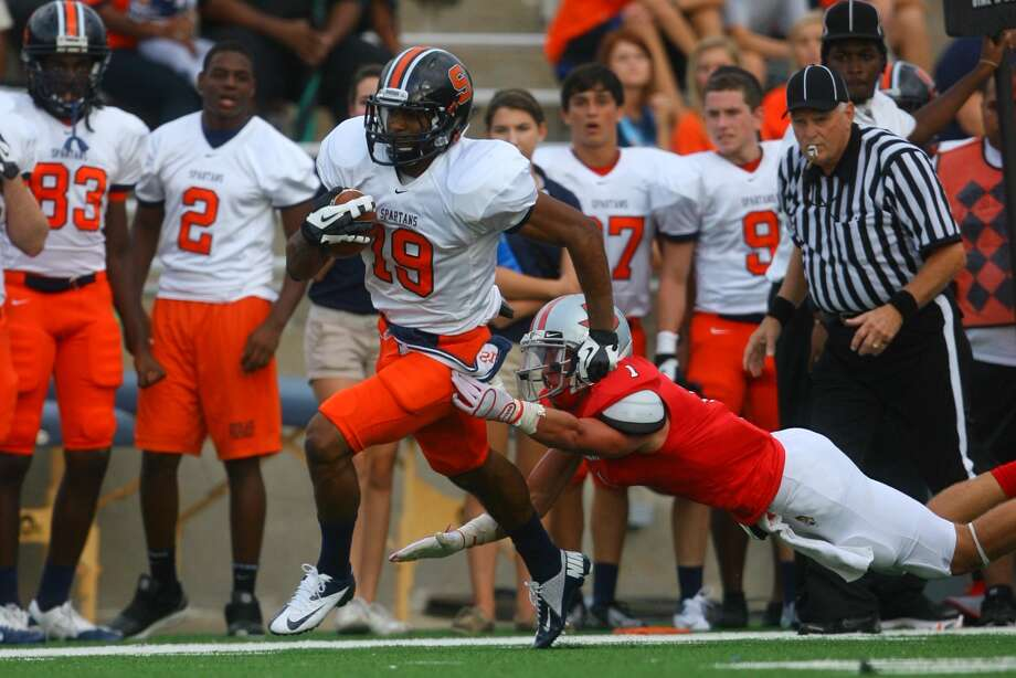 Seven Lakes linebacker John Oglesby returns an interception for a touchdown against Fort Bend Travis. Oglesby and the Spartans look for a 3-0 start to district play with a win over Strake Jesuit on Saturday night. Photo: Matthew White / Freelance