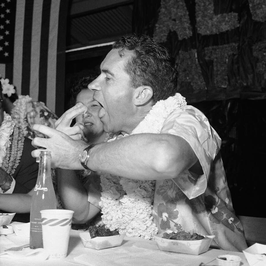 Nixon never learned to stay away from eating starchy pastes with your hands, it never looks good on camera. Photo: ASSOCIATED PRESS / AP1960