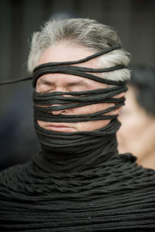 Fit to be tied:An activist from the Movement for Peace with Justice and Dignity protests his government's policies in Mexico City. Photo: Alfredo Estrella, AFP/Getty Images