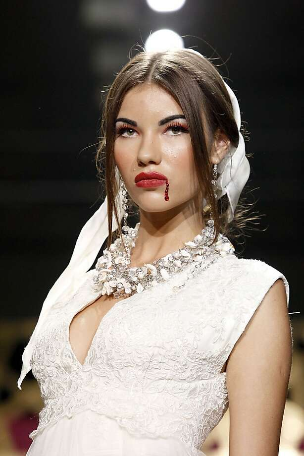 "In Uzbekistan, competition between high-fashion models can be fierce: Close inspection reveals that her ""bloody lip"" is actually a string of red gems. (General Defile By Dom Stilya at the Youth Art Palace in Tashkent.) Photo: Yves Forestier, Getty Images For Style.Uz Art We"