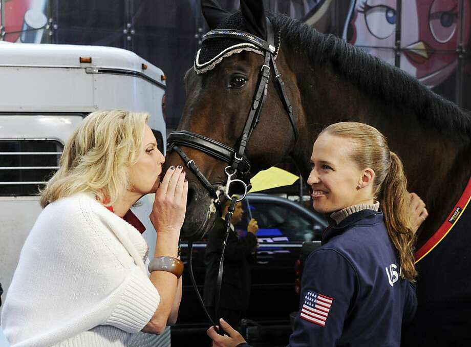 "Rafalca is so jealous:While her husband kisses babies, Ann Romney plants a wet one on Lord Ludger  during ABC's ""Good Morning America."" Ludger and his rider, Rebecca Hart, recently won the USEF National Para-Equestrian Championship. Romney said her love of horses helped her overcome her fear that multiple sclerosis would put her in a wheelchair. Photo: Ida Mae Astute, Associated Press"