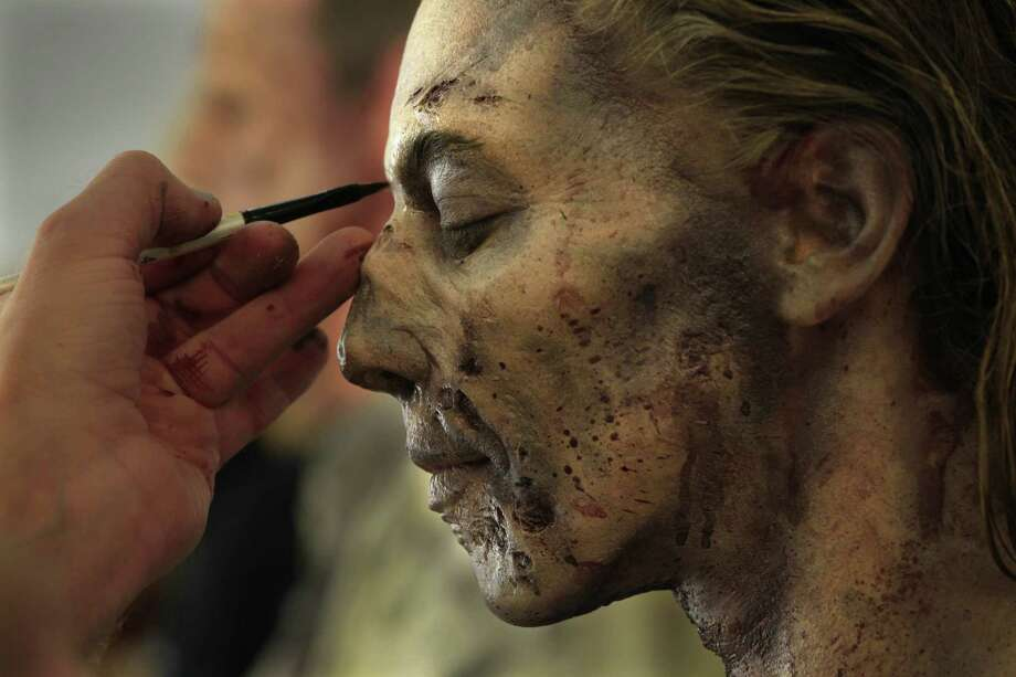 "Stuntwoman Elizabeth Davidovich plays a zombie on the set of ""The Walking Dead."" Photo: Carolyn Cole, McClatchy-Tribune News Service / Los Angeles Times"