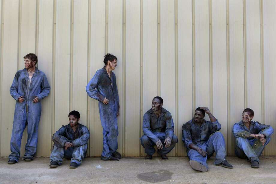 Extras made up as zombies wait their turn. Photo: Carolyn Cole, McClatchy-Tribune News Service / Los Angeles Times
