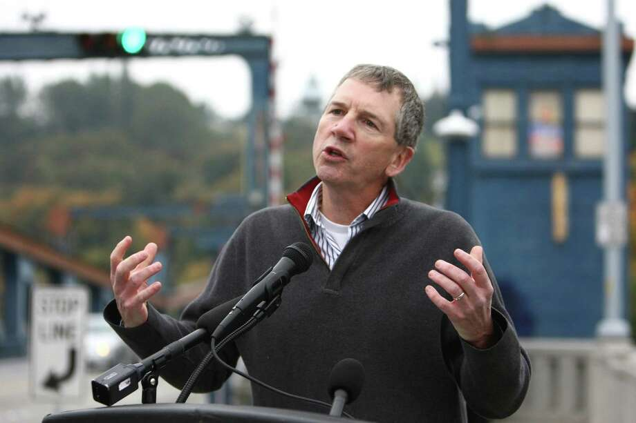 Chuck Ayers, executive director at Cascade Bicycle Club, speaks as a new bike counter is unveiled on the Fremont Bridge on Thursday, October 11, 2012 in Seattle's Fremont neighborhood. The counter will provide data on bicycle use on the popular route, similar to data available for automobiles. Photo: JOSHUA TRUJILLO / SEATTLEPI.COM