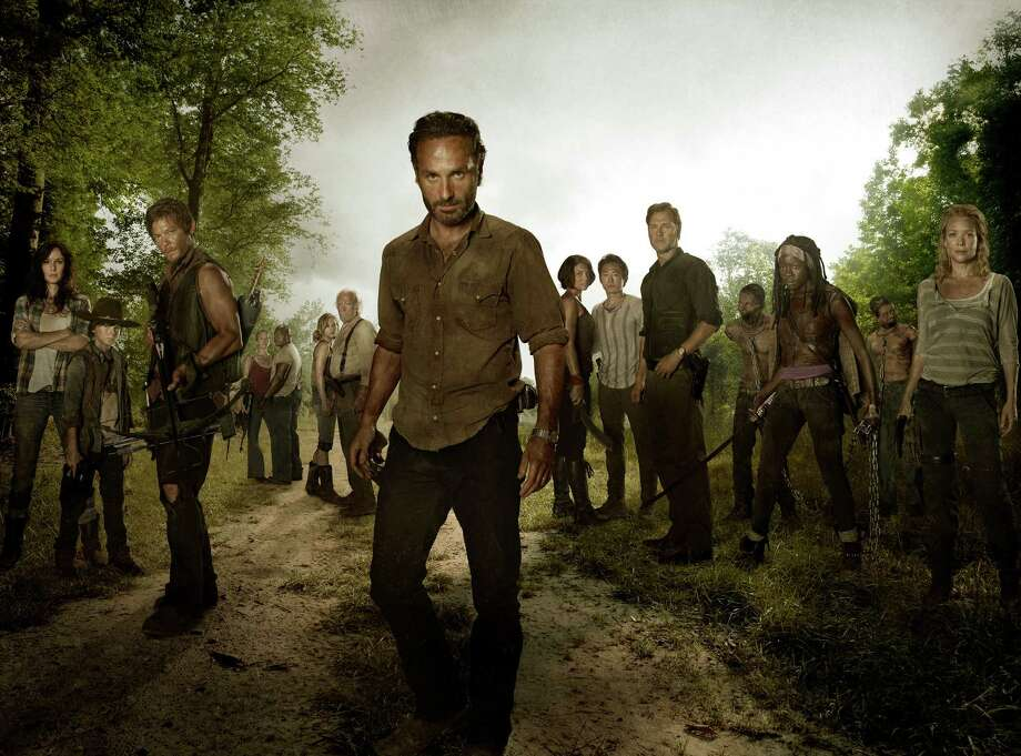 "Some newcomers join the band of survivors on Season 3 of ""The Walking Dead."" (L-R) Lori Grimes (Sarah Wayne Callies); Carl Grimes (Chandler Riggs); Daryl Dixon (Norman Reedus); Carol (Melissa Suzanne McBride); T-Dog (Robert 'IronE' Singleton); Beth Greene (Emily Kinney); Hershel Greene (Scott Wilson); Rick Grimes (Andrew Lincoln); Maggie Greene (Lauren Cohan); Glenn (Steven Yeun); The Governor (David Morrissey); Michonne (Danai Gurira) and Andrea (Laurie Holden) Photo: AMC"