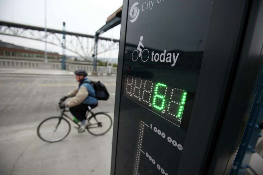 A rider crosses the Fremont Bridge after a new bike counter was unveiled on the bridge on Thursday, October 11, 2012 in Seattle's Fremont neighborhood. The counter will provide data on bicycle use on the popular route, similar to data available for automobiles. Photo: JOSHUA TRUJILLO / SEATTLEPI.COM
