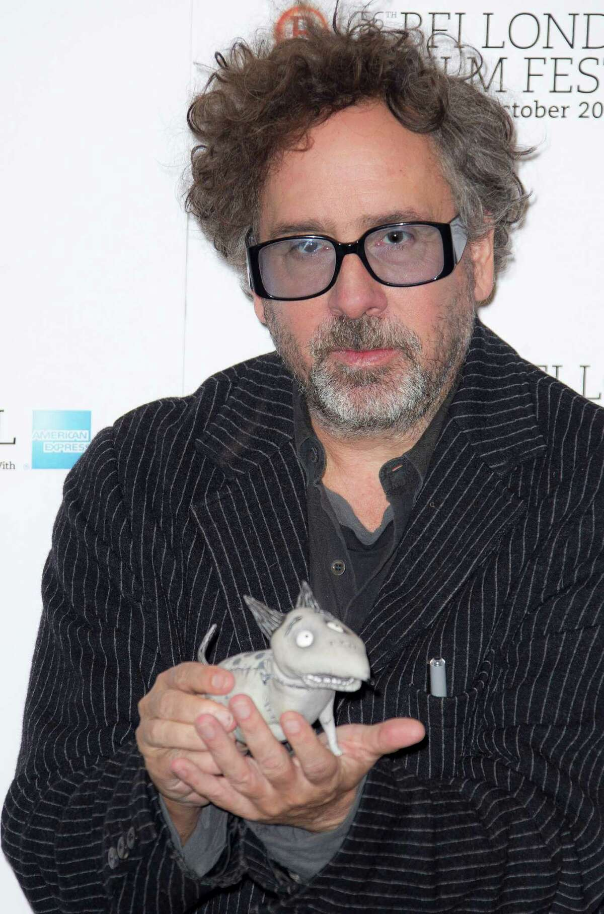 Director Tim Burton holds a
