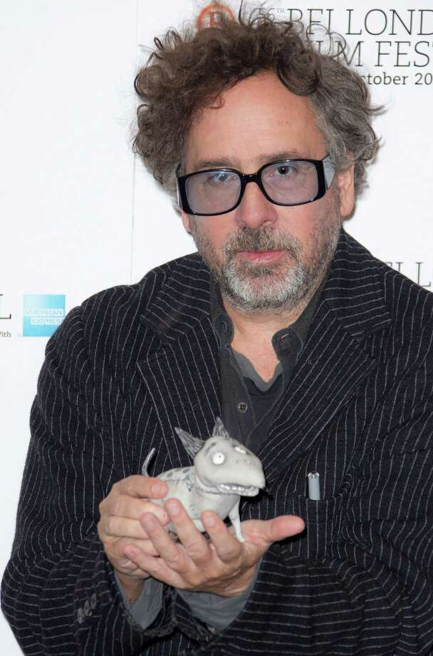 "Director Tim Burton holds a ""sparky"" toy seen at a photocall for his film  ""Frankenweenie""  during the London Film Festival at The Odeon, Leicester Square on Wednesday in London. (Photo by Joel Ryan/Invision/AP) Photo: Ap/getty"