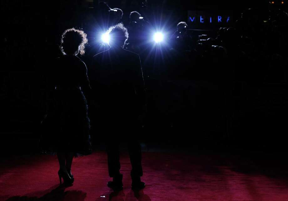 Helena Bonham Carter and filmmaker Tim Burton  attends the opening night film of the 56th BFI London Film Festival 'Frankenweenie 3D' at Odeon Leicester Square on Wednesday in London.  (Photo by Gareth Cattermole/Getty Images for BFI) Photo: Gareth Cattermole, Ap/getty / 2012 Getty Images