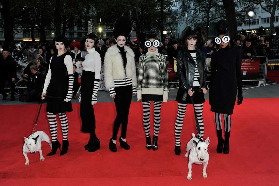 "Models wearing ""Frankenweenie""-inspired fashion dressed by Joseph pose on the red carpet with Sparky at the opening night film of the 56th BFI London Film Festival 'Frankenweenie 3D' at Odeon Leicester Square on Wednesday in London.  (Photo by Gareth Cattermole/Getty Images for BFI) Photo: Gareth Cattermole, Ap/getty / 2012 Getty Images"