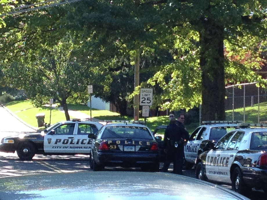 Norwalk police respond to a report of a man with a shotgun on Flax Hill Road in South Norwalk. Photo: Rick Reardon