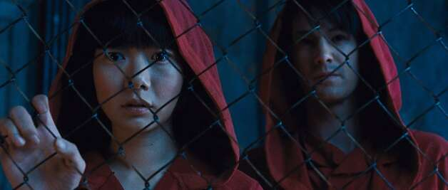 "(L-r) Doona Bae and Jim Sturgess in the epic drama ""CLOUD ATLAS."" Photo: Jay Maidment, Warner Bros."