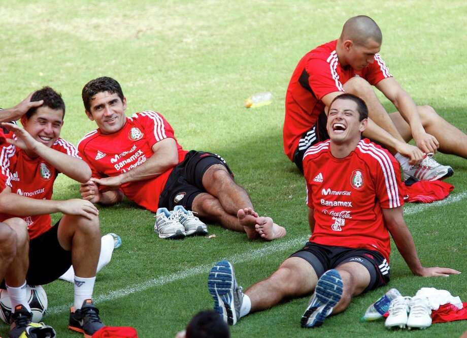 10/11/12 : Javier Hernandez of the Mexico's National team laughs with teammates after practicing at BBVA Compass Stadium in Houston, Texas before playing for World Cup qualifier against Guyana Friday night. Photo: Thomas B. Shea, For The Chronicle / © 2012 Thomas B. Shea