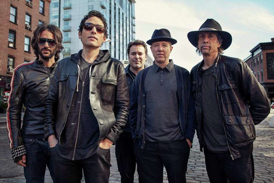 """This Oct. 1, 2012  photo shows members of The Wallflowers, from left, Rami Jaffee, Jakob Dylan, Greg Richling, Jack Irons and Stuart Mathis posing for a portrait  in New York. The Wallflowers released a new album this month titled, """"Glad All Over."""" (Photo by Victoria Will/Invision/AP Images) Photo: Victoria Will"""