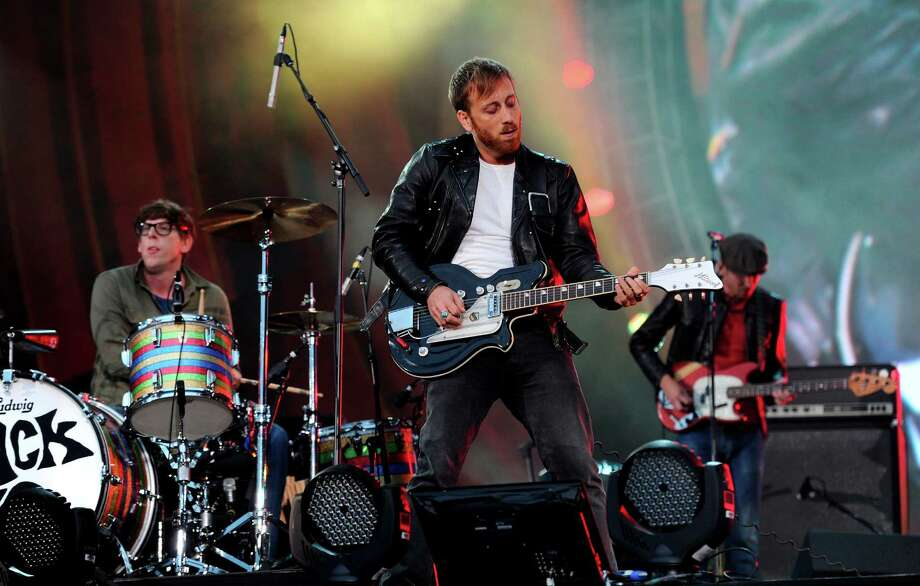 FILE - In this Sept. 29, 2012 file photo, guitarist Dan Auerbach, center, and drummer Patrick Carney of The Black Keys perform at the Global Citizen Festival in Central Park, in New York. At the Austin City Limits Music Festival, about a third of the nearly 130 bands on a lineup that includes the Red Hot Chili Peppers, the Black Keys and Jack White will have their sets broadcast on YouTube. That's a record for the three-day festival that starts Friday, Oct. 12, 2012. (Photo by Evan Agostini/Invision/AP, File) Photo: Evan Agostini
