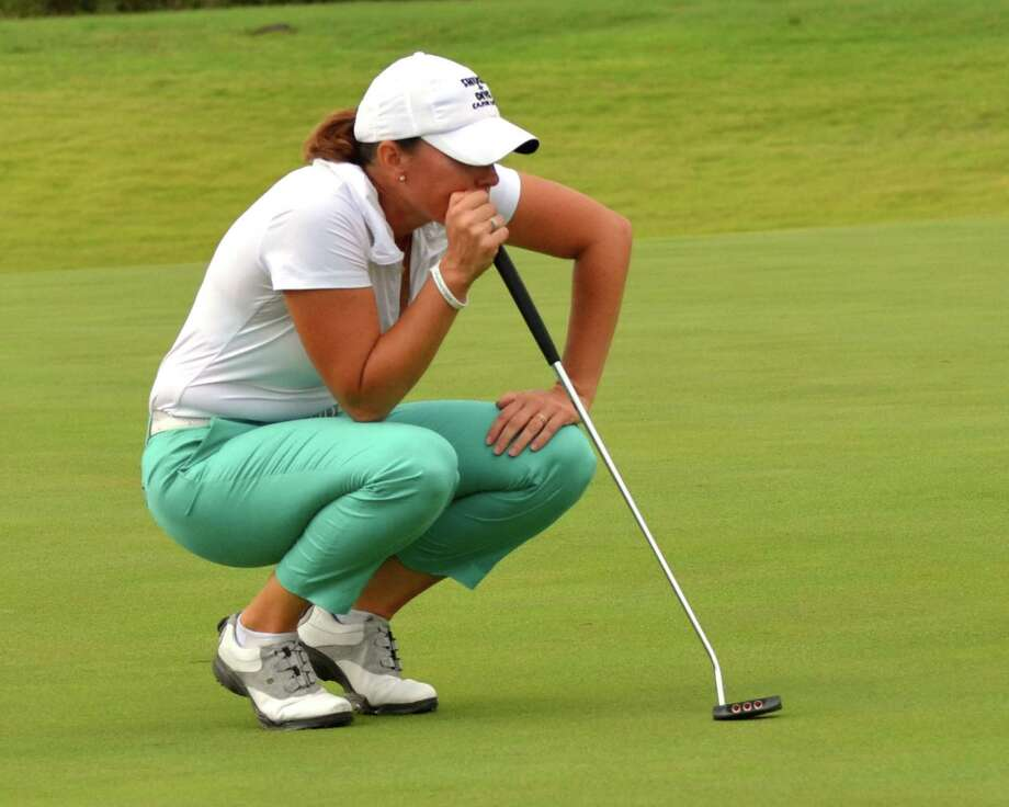 Meghan Stasi studies the line of her putt on No. 9 en route to her 6 and 5 victory in the finals at the U.S. Women's Mid-Amateur Championship on Thursday, Oct. 11, 2012, at Briggs Ranch. Photo: LeAnna Kosub/San Antonio Express-News