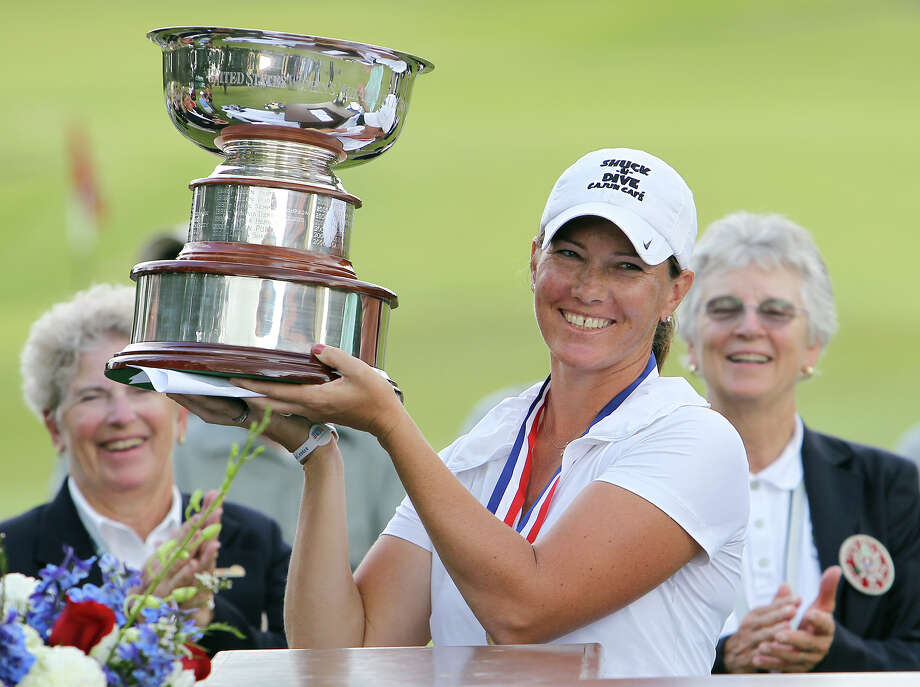 Meghan Stasi of Oakland Park, Florida holds up the winner's trophy after she defeated Liz Waynick of Scottsdale, Arizona, 6&5, at the USGA U.S. Women's Mid-Amateur Championships at Briggs Ranch Golf Club on Thursday, Oct. 11, 2012. Stasi won the title for the fourth time. Photo: Kin Man Hui, San Antonio Express-News / © 2012 San Antonio Express-News
