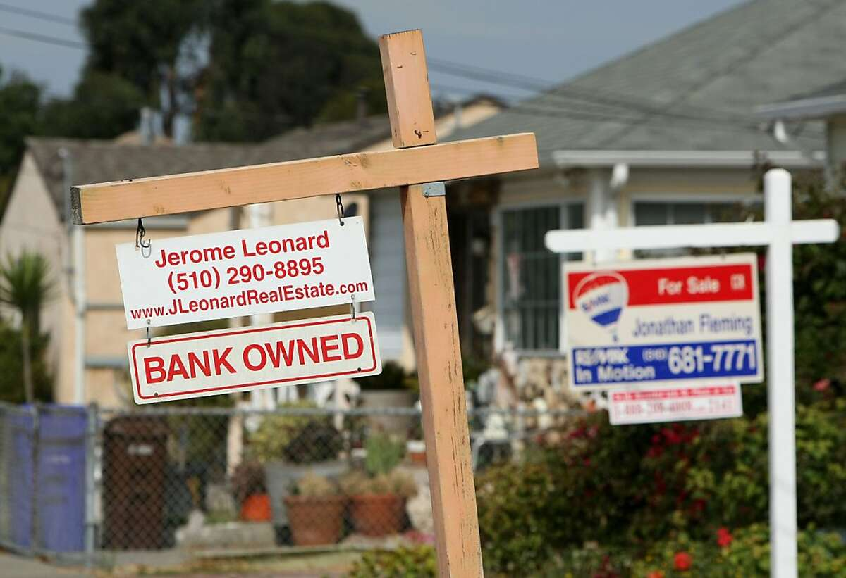 In this file photo, Aa sign is posted in front of a bank owned home that is for sale in Richmond, California.