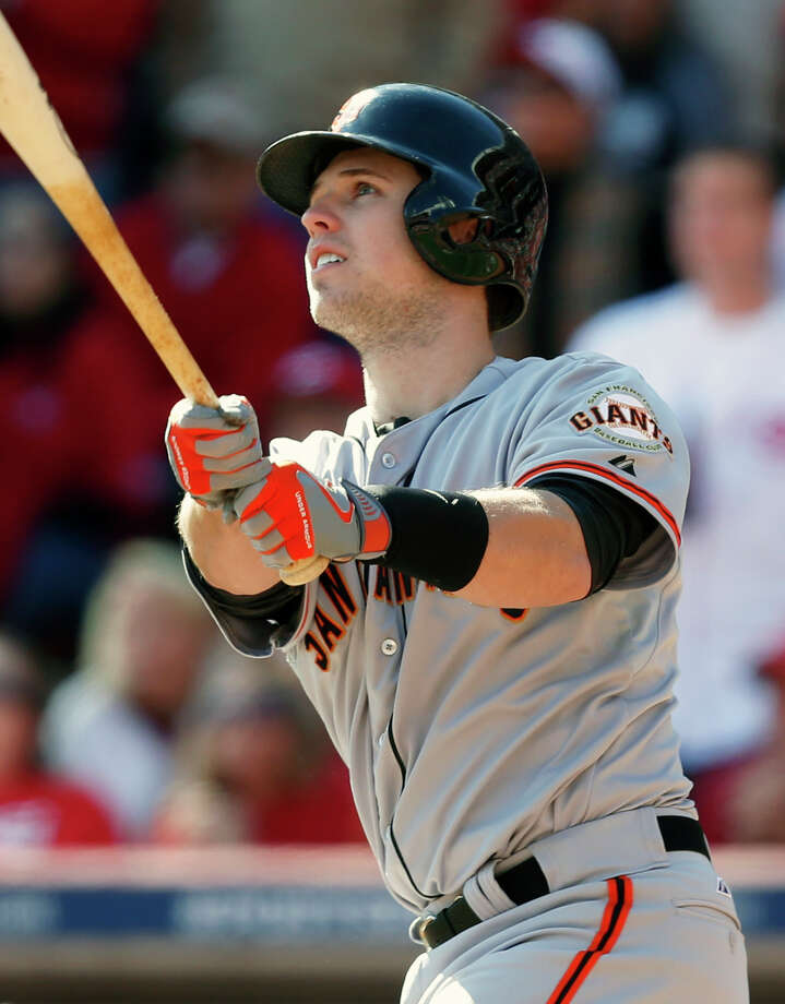 San Francisco Giants' Buster Posey hits a grand slam off Cincinnati Reds starting pitcher Mat Latos in the fifth inning of Game 5 of the National League division baseball series, Thursday, Oct. 11, 2012, in Cincinnati. (AP Photo/David Kohl) Photo: David Kohl, FRE / FR51830 AP
