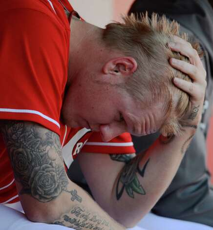 Cincinnati Reds starting pitcher Mat Latos sits in the dugout after giving up a grand slam to San Francisco Giants' Buster Posey in the fifth inning of Game 5 of the National League division baseball series, Thursday, Oct. 11, 2012, in Cincinnati. (AP Photo/Michael Keating) Photo: Michael Keating, FRE / FR170759 AP