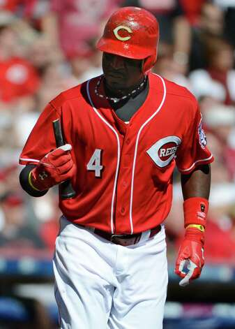 Cincinnati Reds' Brandon Phillips looks at what remains of his bat as he runs up the first base line after breaking the bat lining out to center field in the first inning of Game 5 of the National League division baseball series against the San Francisco Giants, Thursday, Oct. 11, 2012, in Cincinnati. (AP Photo/Michael Keating) Photo: Michael Keating, FRE / FR170759 AP