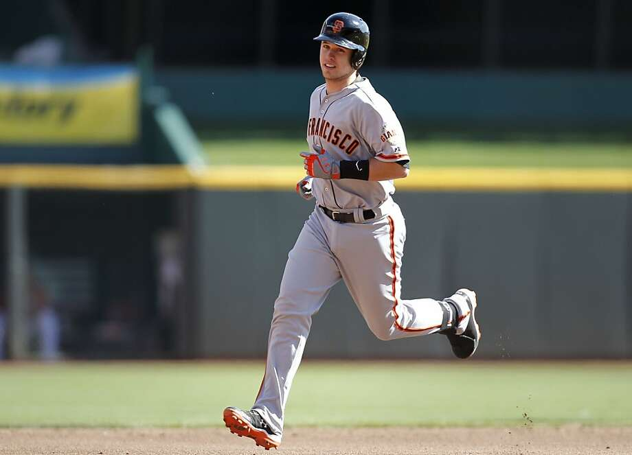 Giants Buster Posey runs the bases after his grand slam in the fifth inning to give the San Francisco Giants a 6-0 lead over the Cincinnati Reds in game five of the National League Division Series in Cincinnati, Ohio on Thursday Oct. 11, 2012. Photo: Michael Macor, The Chronicle