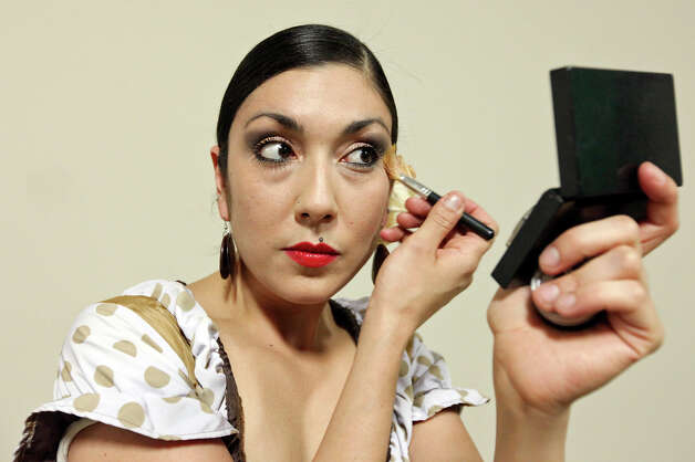 Monica Moncivais, 31, applies makeup before the Perello All Flamenco Fashion Show held Thursday Sept. 13, 2012 at the Say Si Theater. Photo: Edward A. Ornelas / © 2012 San Antonio Express-News