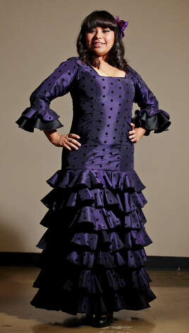 Gabriella Gutierrez, 16, models a flamenco costume by Lisa Perello during the Perello All Flamenco Fashion Show held Thursday Sept. 13, 2012 at the Say Si Theater. Photo: Edward A. Ornelas / © 2012 San Antonio Express-News