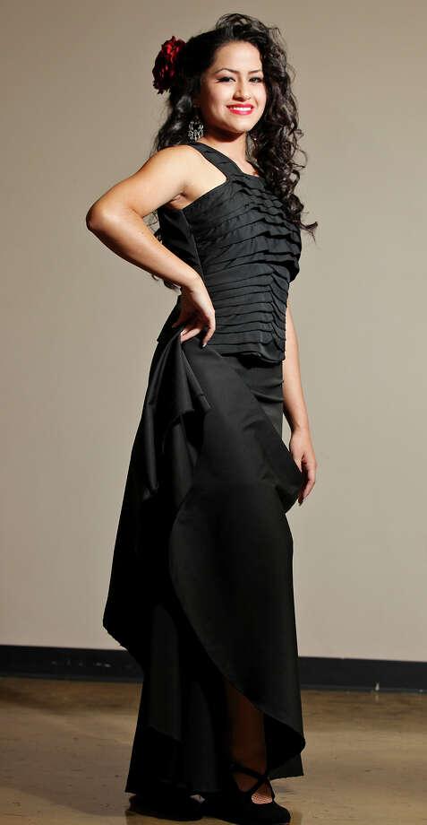 Daniella Espinoza, 16, models a flamenco costume by Lisa Perello during the Perello All Flamenco Fashion Show held Thursday Sept. 13, 2012 at the Say Si Theater. Photo: Edward A. Ornelas / © 2012 San Antonio Express-News
