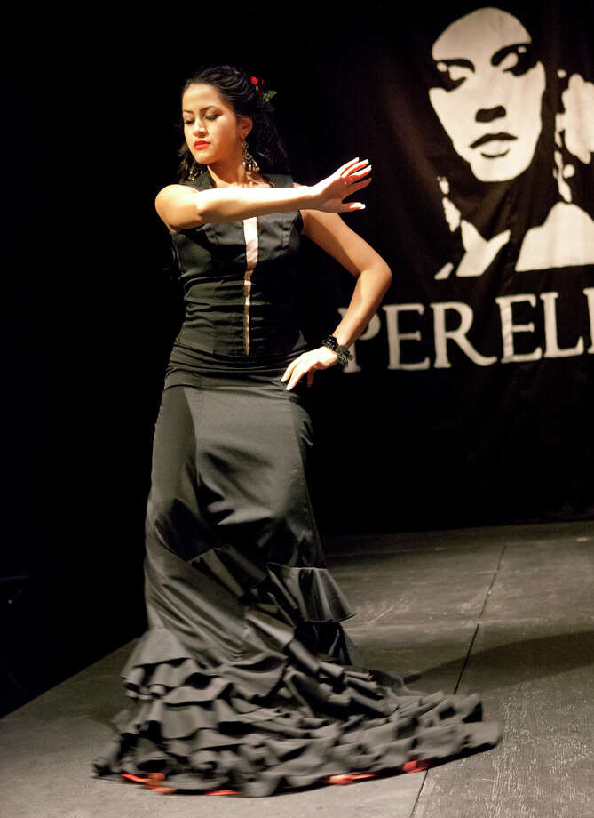 A model performs a flamenco dance on the runway at the All Flamenco Fashion Show of designs by Lisa Perello Trajes de Flamenco in partnership with the ALAS Say Si's Resident Youth Theatre Company at the Say Si theater. Photo: Jamie Karutz, Jamie Karutz/Special / Special to the Express-News
