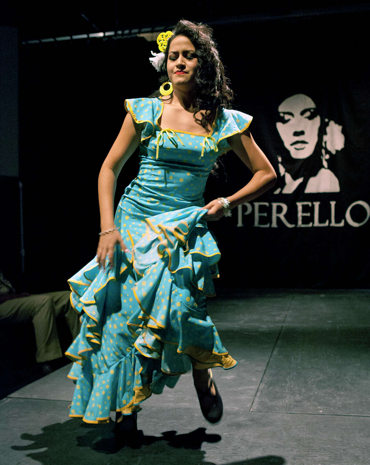Espinosa performs a flamenco dance on the runway at the All Flamenco Fashion Show of designs by Lisa Perello Trajes de Flamenco in partnership with the ALAS Say Si's Resident Youth Theatre Company at the Say Si theater.