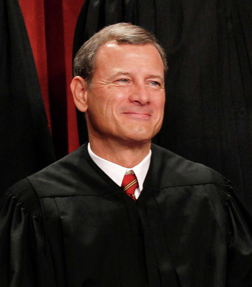 Chief Justice John G. Roberts is seen during the 2010 group portrait at the Supreme Court Building in Washington, D.C. Photo: Pablo Martinez Monsivais, AP Photo/Pablo Martinez Monsivai / 2010 Associated Press