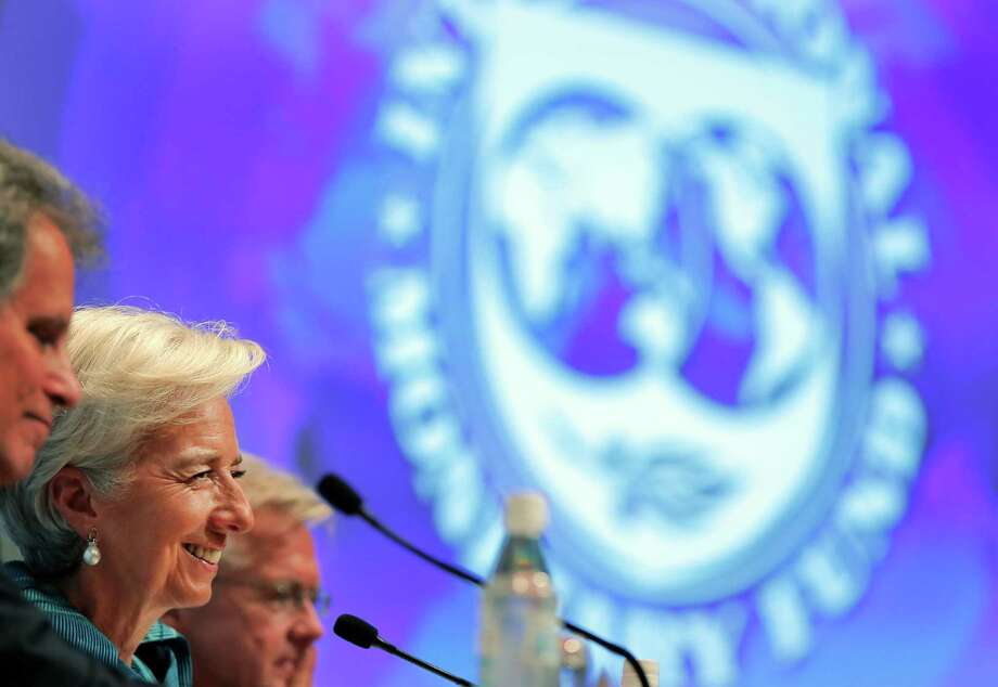 """IMF Director Christine Lagarde, second from left, answers questions Thursday in Tokyo. """"We are not expecting a very, very strong recovery,"""" she said. Photo: Itsuo Inouye / AP"""