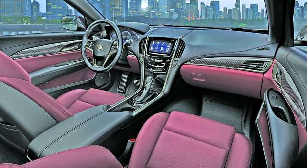The ATS's interior is inviting, luxurious and comfortable. Cue  (Cadillac's User Experience) is the focal point, with a large screen and  larger, more intuitive controls, featuring the first use of capacitive  touch technology in an automobile. Photo: Alan Vanderkaay