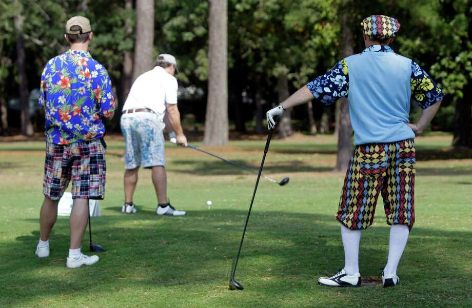 Joel Smith, left, of Houston, and Richard Hunt, of The Woodlands,  watch Keith Chesnutt, of Cypress, hit a tee shot. Photo: Melissa Phillip, Houston Chronicle / © 2012 Houston Chronicle