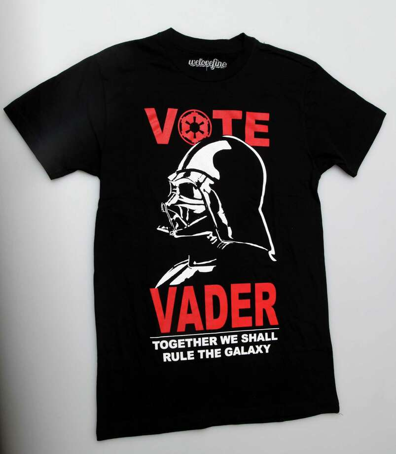 Vote Vader - From $20.50 at Hot Topic. Darth Vader himself said it best. It is useless to resist.  Photo: JUANITO M GARZA / San Antonio Express-News