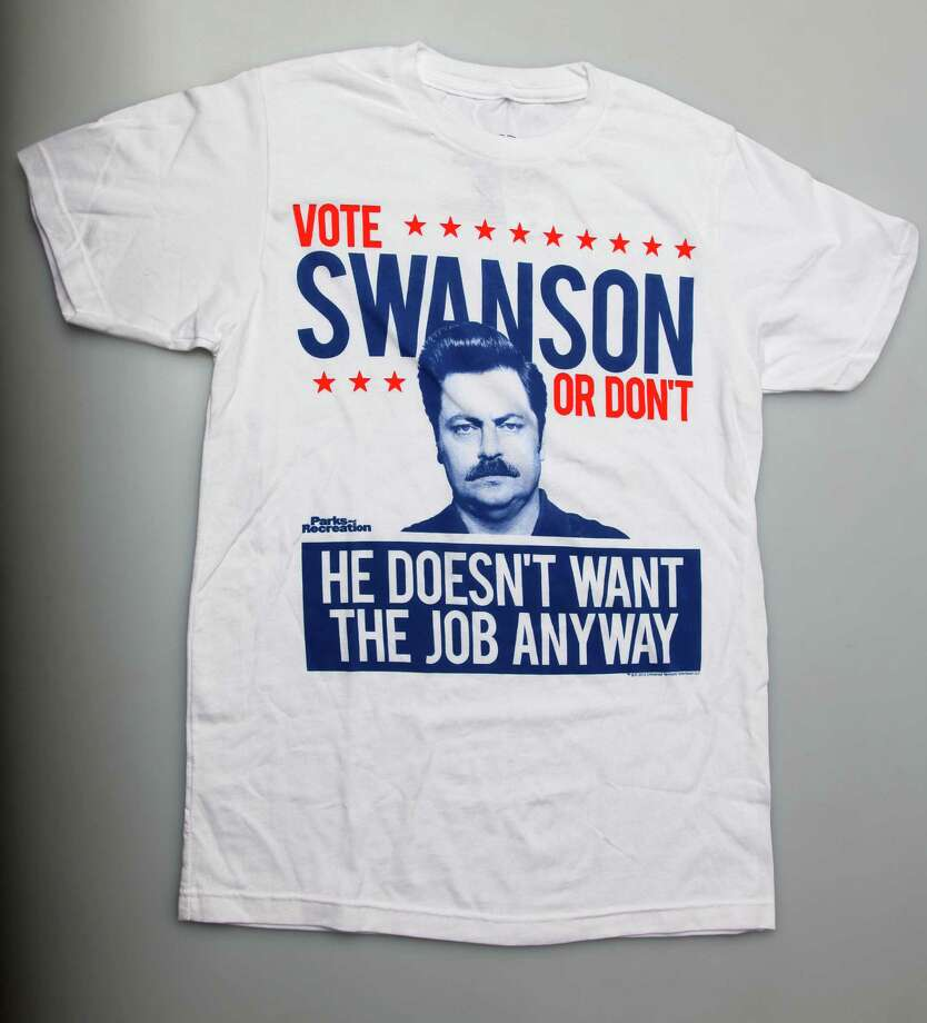 "Vote Swanson or Don't - From $20.50 at Hot Topic. The deadpan libertarian from ""Parks and Recreation"" could sweep through an election like, well, a meat tornado. You know, if he cared. (Juanito M. Garza) Photo: JUANITO M GARZA / San Antonio Express-News"