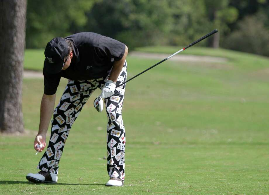 Ed Jones, of Houston, prepares a tee shot. Photo: Melissa Phillip, Houston Chronicle / © 2012 Houston Chronicle