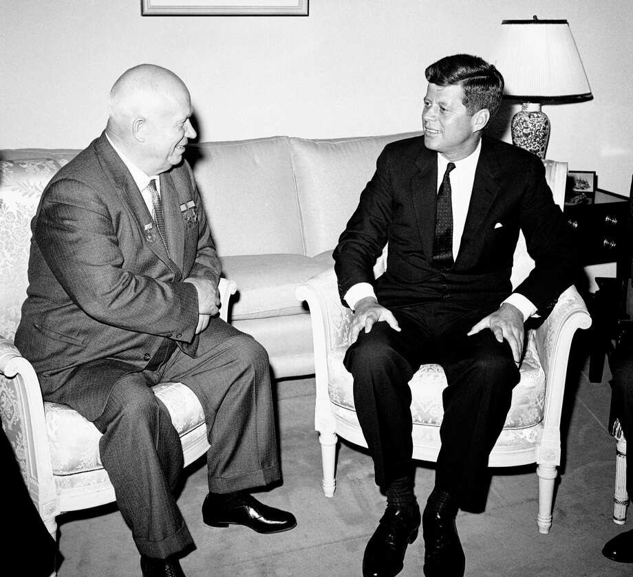 "FILE - In this June 3, 1961, file photo, Soviet Premier Nikita Khrushchev and President John F. Kennedy talk in the residence of the U.S. Ambassador in a suburb of Vienna. The meeting was part of  a series of talks during their summit meetings in Vienna. Fifty years after the Cuban missile crisis, the National Archives in Washington has pulled together documents and secret White House recordings to show the public how President John F. Kennedy deliberated to avert nuclear war. The exhibit opens Friday, Oct. 12, 2012, to recount the showdown with the Soviet Union. It is called ""To the Brink: JFK and the Cuban Missile Crisis."" (AP Photo) / AP"