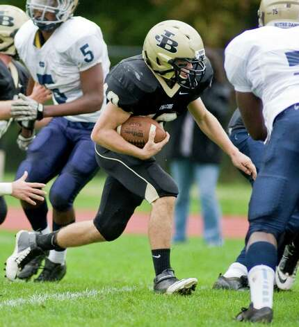 Joel Barlow High School quarterback Jack Shaban cuts through the pack during a football game against Notre Dame-Fairfield. Saturday, Sept. 29, 2012 Photo: Scott Mullin / The News-Times Freelance