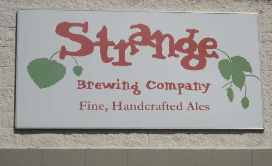 Strange Brewing Company, founded by two laid-off IT employees from the Rocky Mountain News is looking to continue to add capacity as their demand grows.  (Markus Haas / San Antonio Express-News)