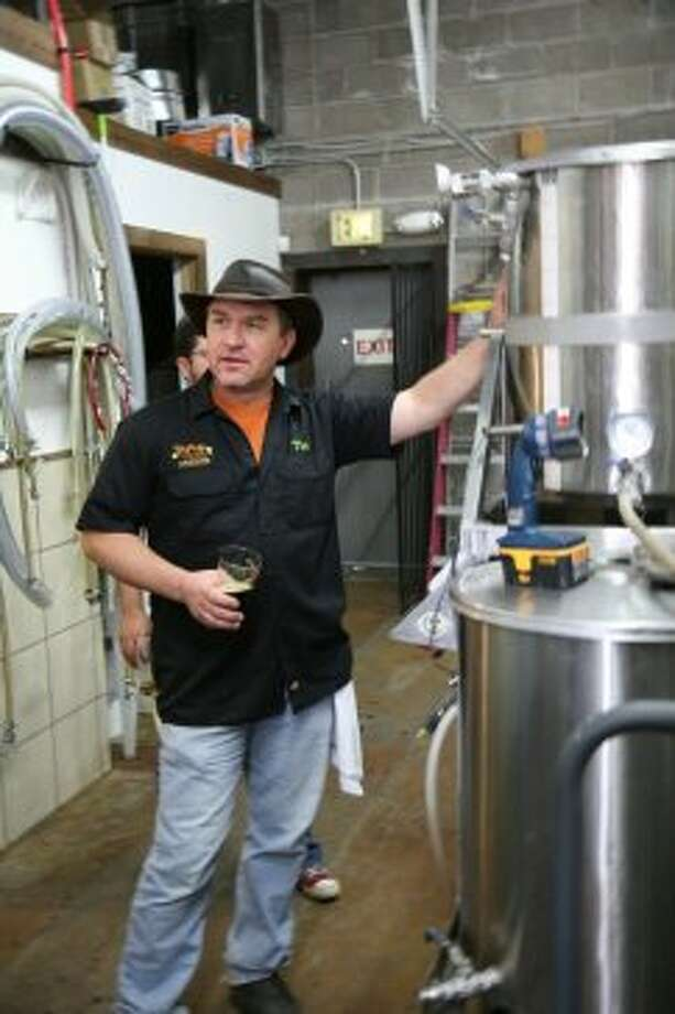 Strange Brewing Company co-founder Tim Myers gives a tour of his brewery in Denver, CO. (Markus Haas / San Antonio Express-News)