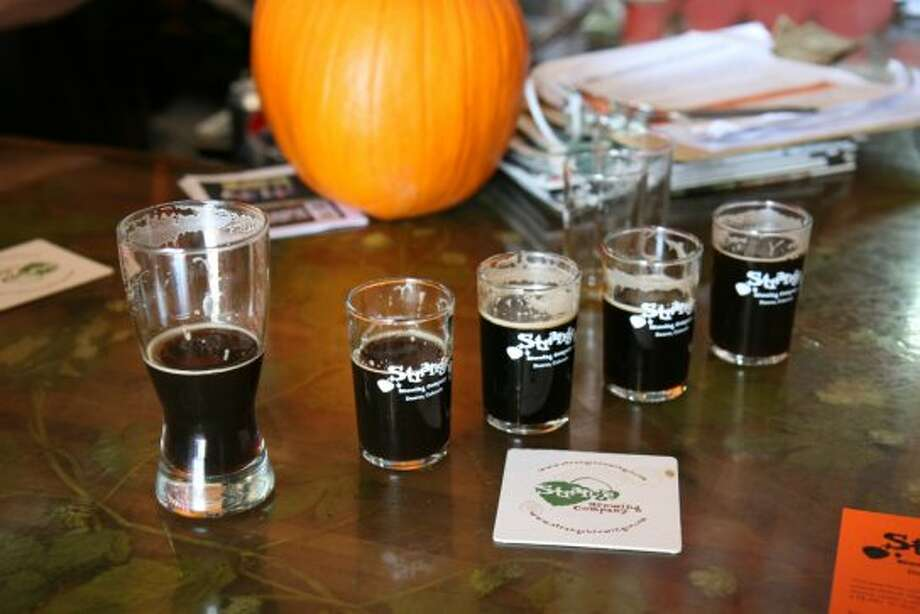 Dark beers abound at Strange Brewing Co, who are featuring a pumpkin porter, coffee stout, sour cherry stout, and a fresh-hopped stout for Denver Beer Week, which includes the Great American Beer Festival (Markus Haas / San Antonio Express-News)