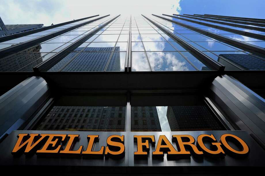 San Francisco-based Wells Fargo, with a big location in New York, is scheduled to report its quarterly earnings Friday. So is JPMorgan Chase. Photo: Peter Foley / © 2012 Bloomberg Finance LP