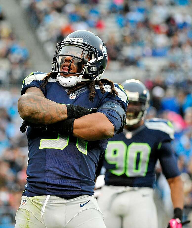 Seattle's Bruce Irvin strikes a pose after sacking Cam Newton of the Panthers on Sunday. Seattle has 15 sacks this season - they had eight in the first half against Green Bay - good for fifth in the NFL. Photo: Grant Halverson, Getty Images