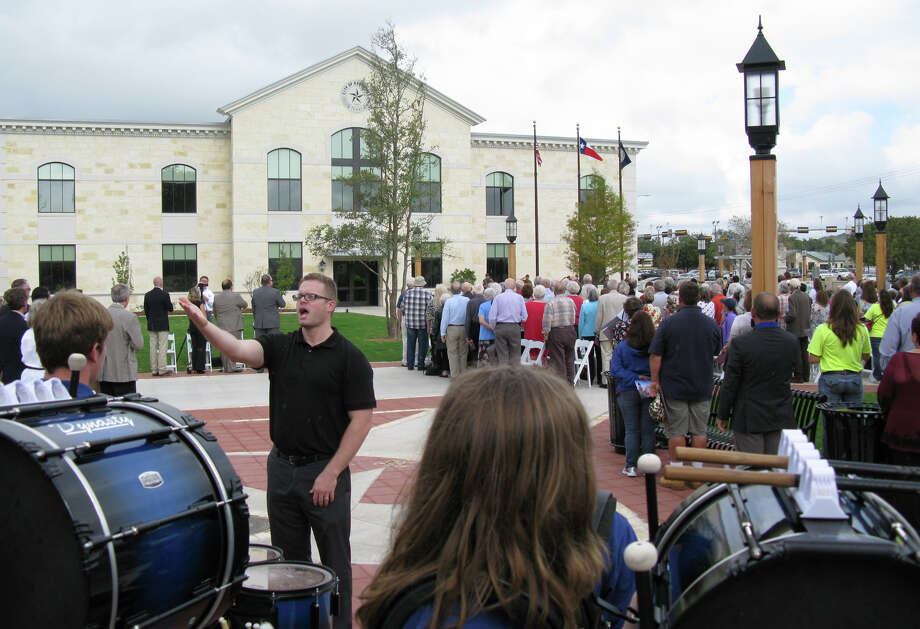 Jeff Thames(center)  leads the Tivy High School camerata in the Star Spangled Banner at Thursday's dedication ceremony for the new Kerrville City Hall (rear). Zeke MacCormack zeke@express-news.net Photo: Zeke MacCormack, San Antonio Express-News / San Antonio Express-News