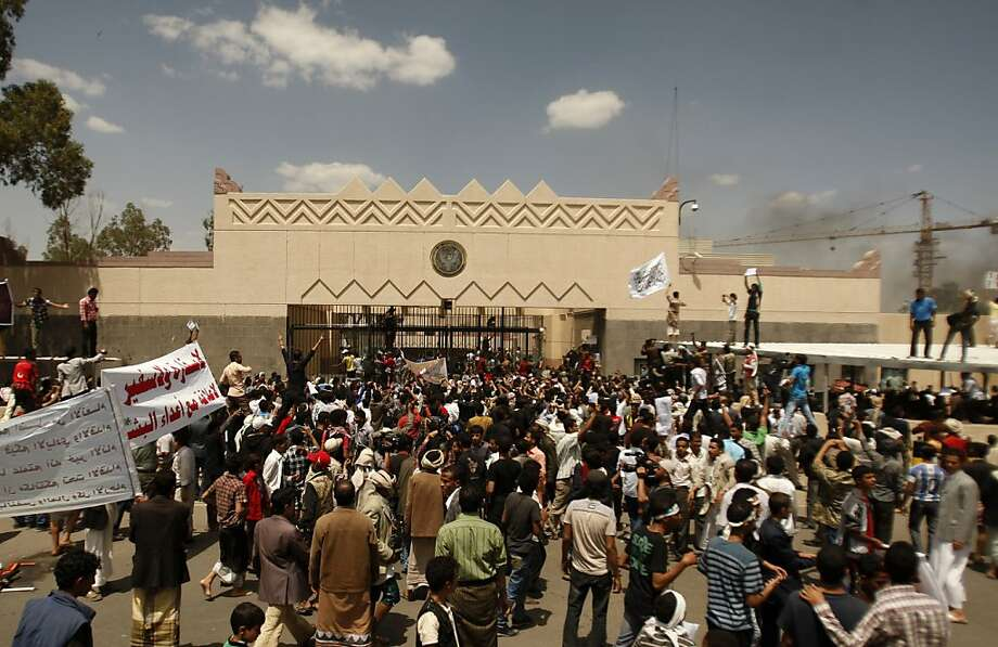 Yemenis protest a video clip last month outside the U.S. Embassy in Sanaa. A top Yemeni security official who worked at the embassy was killed Thursday. Photo: Hani Mohammed, Associated Press